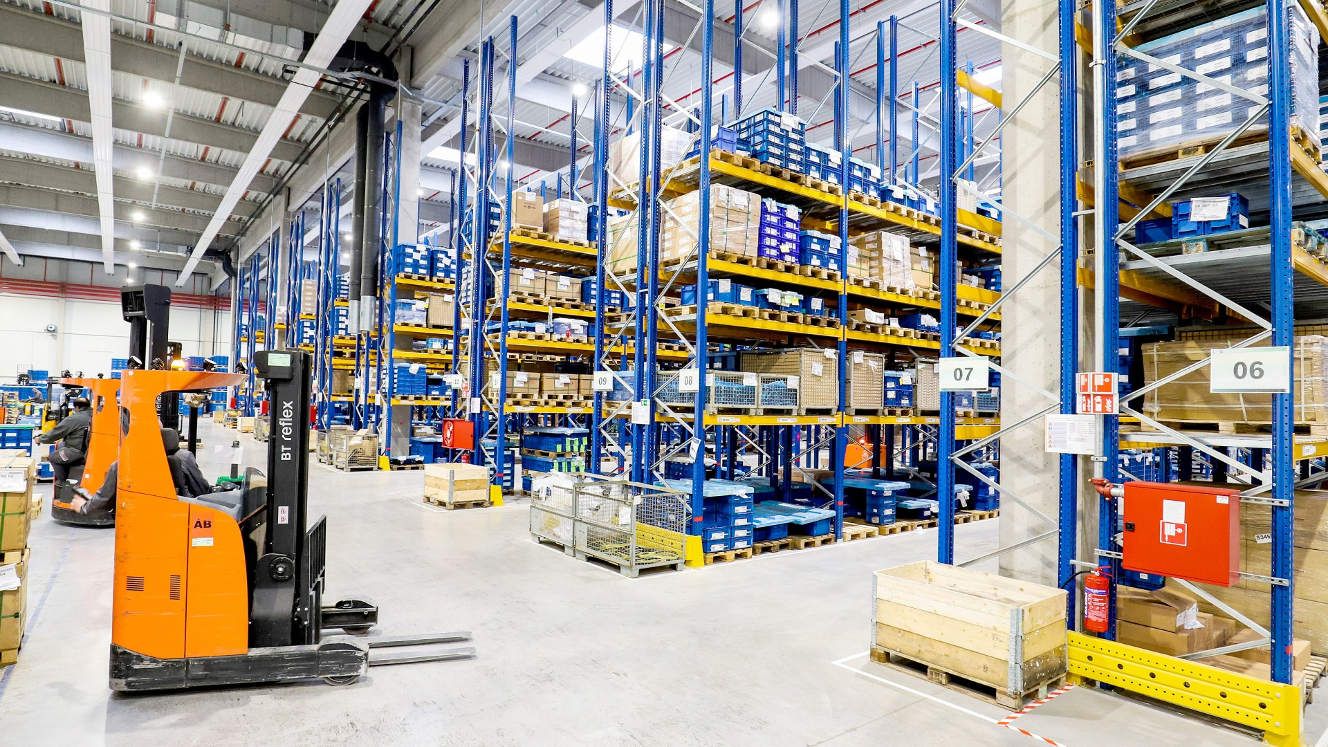 High racks and forklift in a logistics center